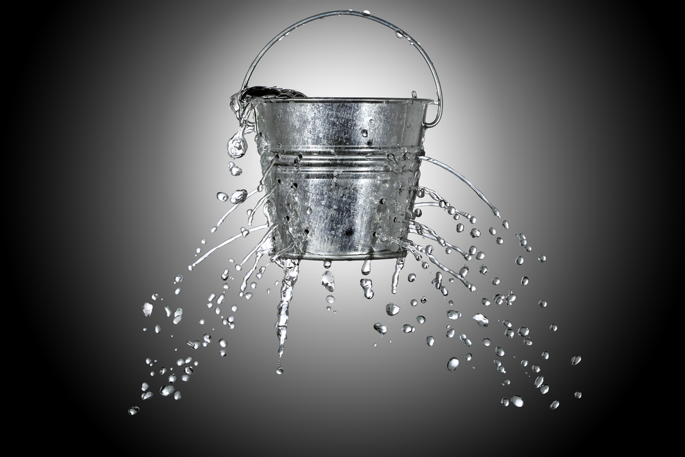 water-is-coming-out-of-a-bucket-with-holes